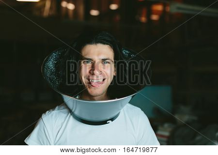 Male model wearing fooling around his neck reflector diffuser. Dog Recovery Collar Cones