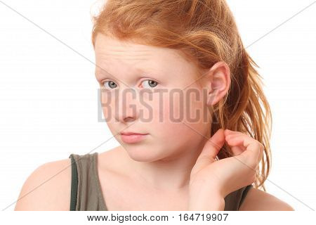 Portrait of a thoughtful teenage girl on white background