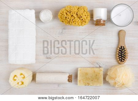 Beauty threatment products on wooden board with copyspace in center
