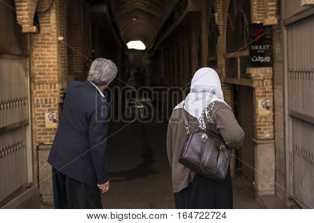 Tehran IRAN - January 6 2017 Back view of A Man and Woman In Front of Tehran Old Covered Bazaar Passage.