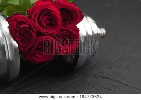 Sports Background With Dumbbell And Roses.