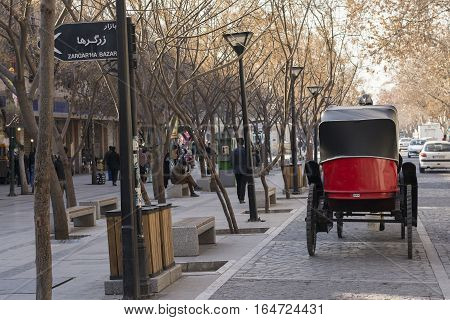 Tehran IRAN - January 6 2017 Back View of Traditional Old-fashioned Fiacre Horse-driven Carriage Through The Tehran Down Town Street