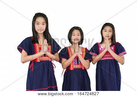 kids in hill tribe costume welcome pose Thai style sawadee on white