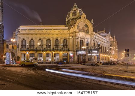 PRAGUECZECH REPUBLIC JANUARY 8 2017: Winter snowy View of Municipal House at the Republic Square in Prague. The Old Town is famous destination in Prague.