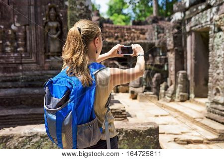 Tourist Taking Photo Of The Temple In Angkor, Cambodia