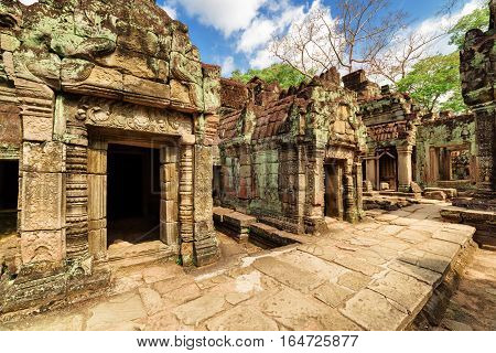 Mossy Buildings Of Ancient Preah Khan Temple In Angkor, Cambodia