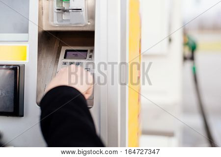 Woman Paying With Credit Card For Fuel