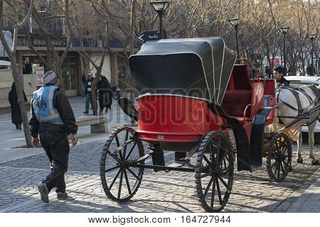 Tehran IRAN - January 6 2017 Back View of Traditional Old-fashioned Fiacre Horse-driven Carriage Through The Tehran Down Town Street.