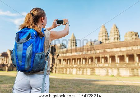 Tourist Taking Picture Of The Angkor Wat, Cambodia