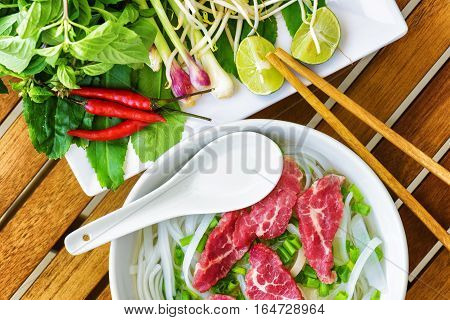 Top View Of The Pho Bo. Popular Beef Noodle Soup Of Vietnam