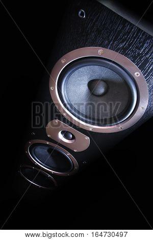 Sound speaker close-up. Audio stereo system on black background