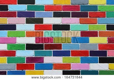 Abstract colorful brick wall pattern painted bricks urban texture backdrop