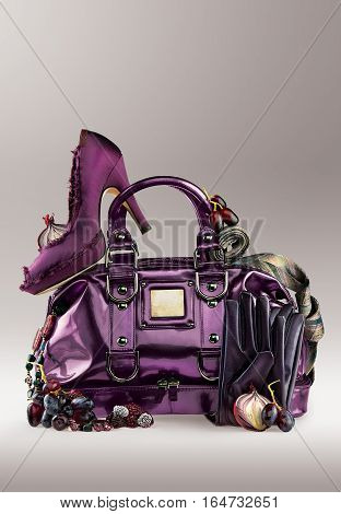 Purple trendy stylish women's handbag and shoes. Travel and fashion.