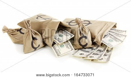 Bags With Wads Of Money. Isolated On A White Background.