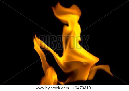 Fire flames isolated on black background. Woman and part of a face silhouette
