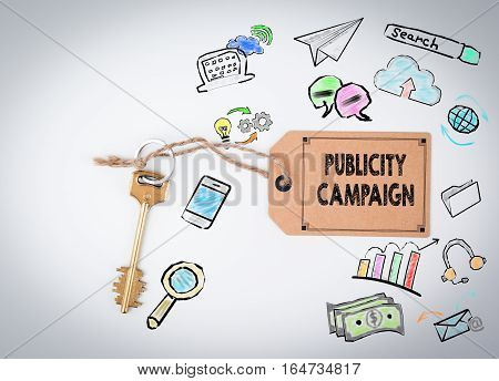 Publicity Campaign. Key and a note on a white background