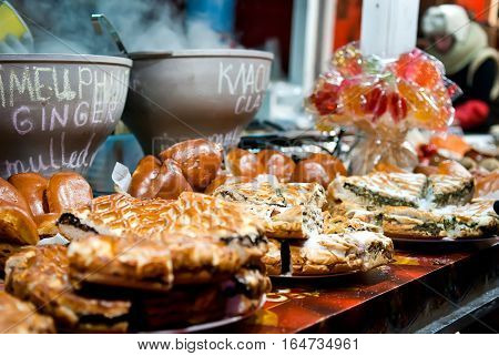 Kyiv Ukraine - Jan 8 2017: Christmas market stalls with hot mulled wine baked goods on Sophia Square in Kyiv. There are many stalls selling gifts and also serving up seasonal food and drink