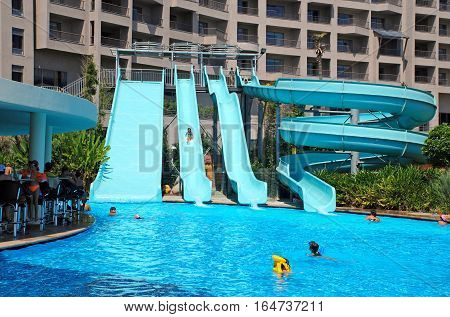 BELEK, TURKEY - AUGUST 13, 2008: children sliding down a water slide at summer resort hotel, Belek, Turkey.