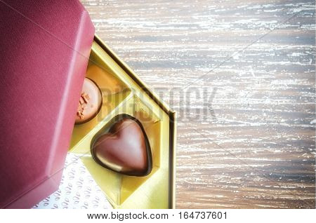 Close up of chocolate heart shape candy in box. Romantic gift for couples in love. Valentines Day or love concept.