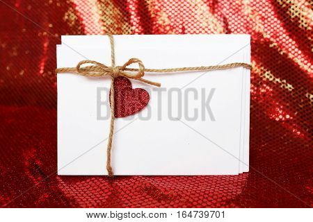 Valentine's  Day Envelope With Bow And Heart Sticker On Red Sparkly Background