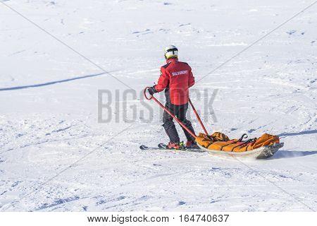 Poiana Brasov Romania- January 24 2016: Skier on the ski pulling a mountain rescue stretcher down