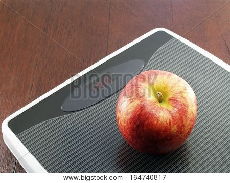Apple on weight scale, diet concept for weight control by eating fruit