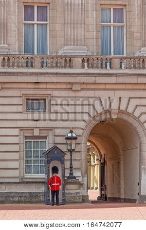 LONDON, UK - JULY 11, 2012: A guard on duty at Buckingham Palace in London, England.