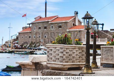 Coast venetian fortress Castello in Petrovac, Montenegro - popular tourist attraction. Old citadel, embankment and quay in Petrovac.