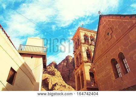 Church and monastery in Saint Catherine next to Moses' mountain (Egypt Sinai). Famous place for Christianity Orthodoxy pilgrims. Tinted toned coloration image