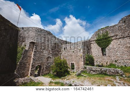 Ancient stone ruins and fortress wall of Old Bar town, Montenegro. Stari Bar - ruined medieval city on Adriatic coast, Unesco World Heritage Site.
