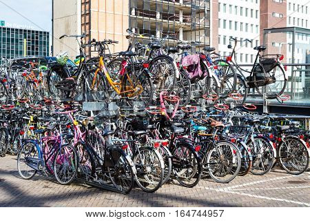 Leiden, Netherlands - April 7, 2016: Bicyces two level parking in the street in Holland town Leiden, Netherlands