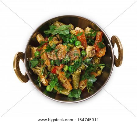 Vegan and vegetarian dish, spicy pea salad in copper bowl. Indian cuisine, vegetable mix with herbs, healthy meal isolated on white background. Eastern local cuisine restaurant food top view