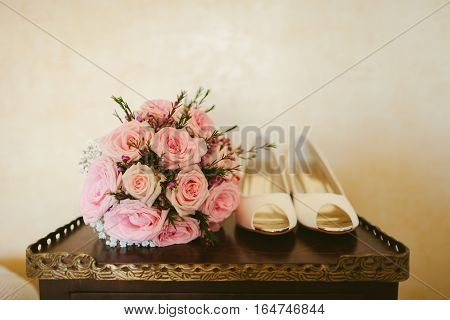 fancy wedding shoes. Bridal shoes and bouquet