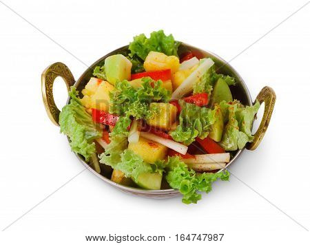 Vegan and vegetarian dish, fresh vegetable salad in copper bowl. Indian restaurant, lettuce and fruits mix with herbs, healthy meal, closeup isolated on white background. Eastern local cuisine food.