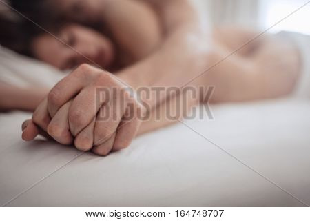 Intimate Couple Holding Hands While Having Sex