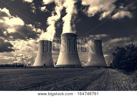 Thermal power plant with dramatic dark sky,