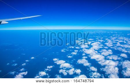 Save Aerial view from airplane airplane with beautiful sky
