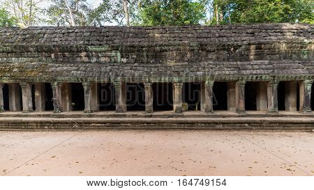 Siem Reap, Cambodia - December 07, 2015: Corridor from Ta Prohm temple at Angkor Archaeological Park of Siem Reap in Cambodia
