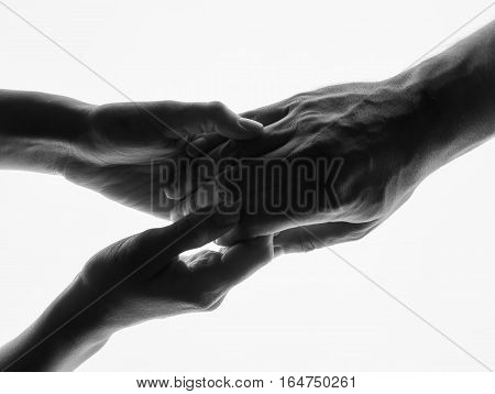 Touching hands silhouette man woman white background couple feeling love. Man woman hold hands silhouette white background. Couple Holding Hands Closeup. Black and white photo