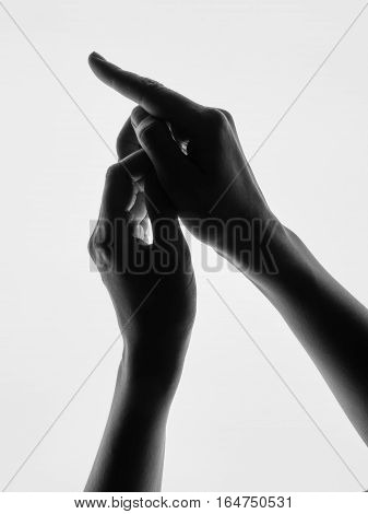 Woman hands silhouette white background forefinger points on. Black and white photo picture