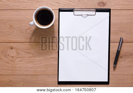Mockup for check list, empty note paper with pen and coffee cup on brown wood background. Office, writer or study concept