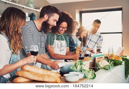 Multiracial Friends Cook Tasteful Food.