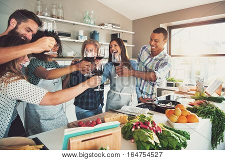 Group Of Celebrating Friends At Cooking Party
