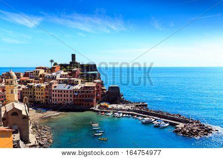 Vernazza famous fisherman village on steep Cinque Terre coast of the mediterrean sea.
