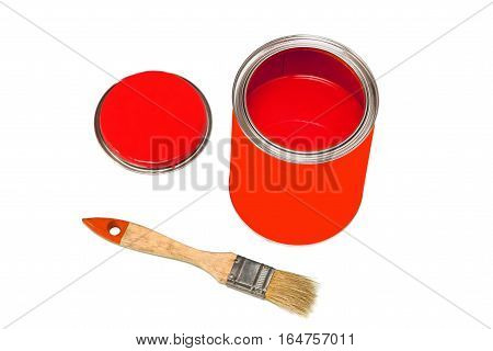 Bank of red paint and paintbrush isolated on white background.