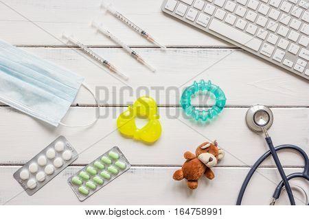concept wooden desktop children doctor top view.