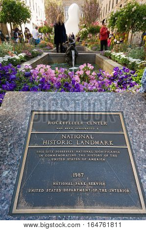 NEW YORK - APRIL 30 2016: Memorial stone at the famous Rockefeller Center in Manhattan saying the center has been designated a national historic landmark