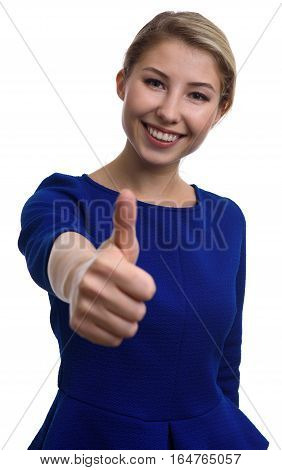 Successful Young Woman Gesturing Thumbs Up