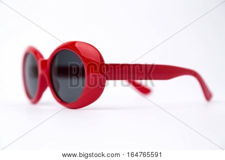 red round Sun glasses isolated on white