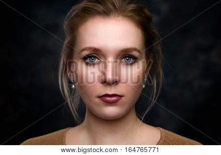 portrait of a beautiful woman with healthy smooth skin and natural makeup